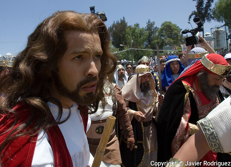 Christian Ramses Reyes portrays Jesus Christ as he is escorted by Roman soldiers during the Via Crucis in the neighborhood of Iztapalapa, April 14, 2006. Almost a million people attend the procession of Good Friday in this  neighborhood of Mexico City, where for 163 years the Iztapalapa neighborhood residents have taken part in a re-enactment of Christ's crucifixion.  Photo by © Javier Rodriguez