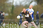Shanked: Kieran O'Callaghan Castleisland Desmonds punches the ball away from Seamus Scanlon Currow during their Intermediatte Championship clash in Currow on Sunday