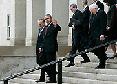 Arlington, VA - January 4, 2006 -- United States President George W. Bush waves for the cameras with (left to right) Secretary of Defense Donald Rumsfeld, National Security Advisor Steve Hadley, Vice President Dick Cheney and Secretary of State Condoleezza Rice in tow  January 4, 2006 at the Pentagon in Arlington, Virginia. Bush was at the Pentagon for a briefing on the war by top commanders. He also offered condolences to the families of the 12 West Virginia miners who were found dead after a frantic rescue effort following an explosion at the Sago mine January 2, 2006.<br /> Credit: Alex Wong - Pool via CNP