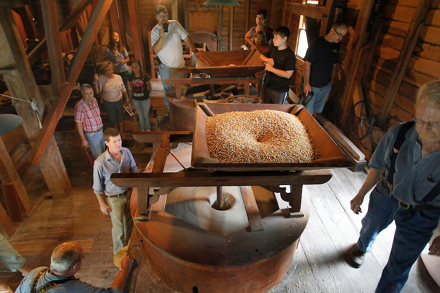 White corn is ground into cornmeal using a one-ton stone powered by a water wheel at the historical Woodson's Mill in Nelson County, Va. The restored mill first opened in 1792. Photo/Andrew Shurtleff