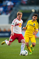 Dax McCarty (11) of the New York Red Bulls is marked by Matías Sanchez (8) of the Columbus Crew. The New York Red Bulls and the Columbus Crew played to a 2-2 tie during a Major League Soccer (MLS) match at Red Bull Arena in Harrison, NJ, on May 26, 2013.
