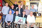 Con O'Mahony, captain Murphys Bar Golf Society, Killarney, pictured as he presened first prize to Paul Corridan, winner of the clubs outing to Kenmare on Saturday. Also pictured are Sean Murphy, president, Mossie Foley, sponsor, Ger Moroney, Gerry Adams, Mike Casey, Paul O'Donoghue, Thomas McCloskey, Pat Kissane and Jimmy Smith.