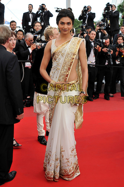 DEEPIKA PADUKONE.Attending the 'On Tour' premiere during the 63rd International Cannes Film Festival, Cannes, France,.12th May 2010..arrivals  full length white gold sari dress Indian cuff bracelet clutch bag embroidered .CAP/PL.©Phil Loftus/Capital Pictures.