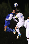 06 November 2012: Duke's Jonathan Aguirre (left) and UNC's Jordan Gafa (14) challenge for a header. The University of North Carolina Tar Heels defeated the Duke University Blue Devils 1-0 at Fetzer Field in Chapel Hill, North Carolina in a 2012 NCAA Division I Men's Soccer game. The game was an Atlantic Coast Conference quarterfinal match.