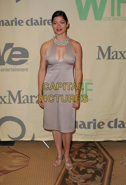 """JILL HENNESSY.Attend """"A Family Affair: Women in Film celebrates The Paltrow Family"""" 2004 Crystal & Lucy Awards held at The Westin Century Plaza Hotel in Century City, California.June 18, 2004.full length, full-length, halterneck, plunging neckline, cut out, cleavage, silk, satin dress, diamond collar, jeweelery.www.capitalpictures.com.sales@capitalpictures.com.©Debbie VanStory/Capital Pictures.."""