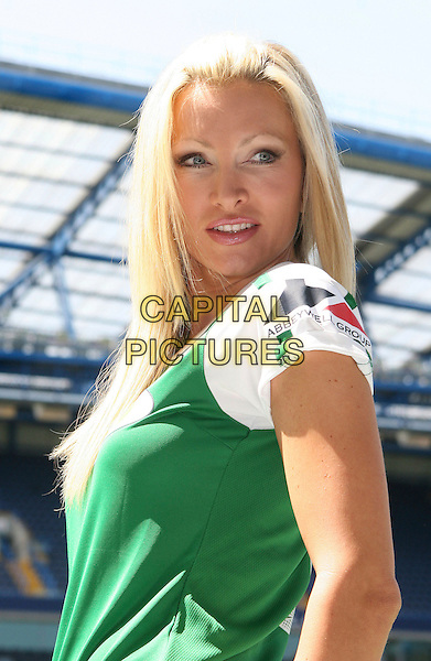 CAPRICE BOURRET.Celebrity Soccer Six in aid of The Samaritans held at Chelsea Football ground, Stamford Bridge, London, England, UK, May 24th 2009.football match game half length green white top t-shirt .CAP/JIL.©Jill Mayhew/Capital Pictures