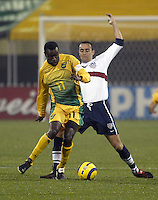 Theodore Whitmore, left, Ramiro Corrales, right, World Cup qualifier, Jamaica v USA, 2004.