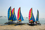 Colorful sailboats leaving the dock