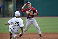 Florida State Seminoles shortstop Justin Gonzalez (10) attempts to turn a double play as Michael Arencibia (35) slides in during a game against the South Florida Bulls on March 5, 2014 at Red McEwen Field in Tampa, Florida.  Florida State defeated South Florida 4-1.  (Mike Janes/Four Seam Images)
