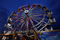 The Ferris Wheel lights up the sky at dusk during the SEMO District Fair on Wednesday, Sept. 15, 2010 in Cape Girardeau, Missouri.