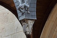 Sculptural detail on the entrance porch on the external facade of Les Hospices de Beaune, or Hotel-Dieu de Beaune, a charitable almshouse and hospital for the poor, built 1443-57 by Flemish architect Jacques Wiscrer, and founded by Nicolas Rolin, chancellor of Burgundy, and his wife Guigone de Salins, in Beaune, Cote d'Or, Burgundy, France. The buildings, set around an internal courtyard, are in Northern Renaissance and Flamboyant Gothic style, with half-timber galleries, ornate rooftops with Burgundian glazed tiles in geometric patterns and dormer windows. The hospital was run by the nuns of the order of Les Soeurs Hospitalieres de Beaune, and remained a hospital until the 1970s. The building now houses the Musee de l'Histoire de la Medecine, or Museum of the History of Medicine, and is listed as a historic monument. Picture by Manuel Cohen