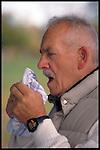 elder man sneezing