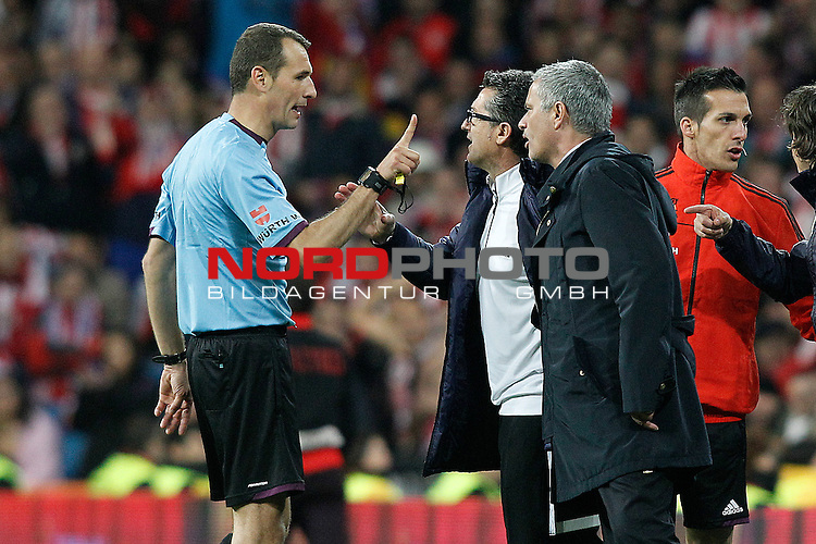 Real Madrid's coach Jose Mourinho have words with the referee Carlos Clos Gomez during spanish KIng's Cup Final match.May 17,2013. Foto © nph / Acero)