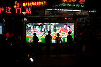 Night Landscape View Of People Waiting For A Bus At A Bus Station In Chongqing, China.  © LAN