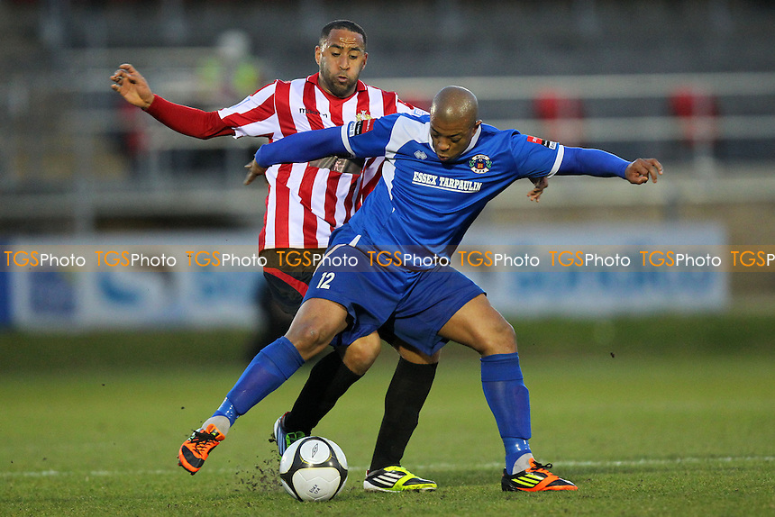 Michael Spencer of Hornchurch evades Leon Lalite of Grays - AFC Hornchurch vs Grays Athletic - Essex FA Senior Cup Final at Dagenham & Redbridge FC - 15/04/13 - MANDATORY CREDIT: Gavin Ellis/TGSPHOTO - Self billing applies where appropriate - 0845 094 6026 - contact@tgsphoto.co.uk - NO UNPAID USE.