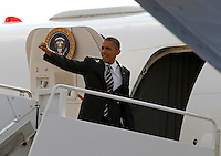 President Barack Obama boards his plane after a campaign stop in Charlottesville, VA.