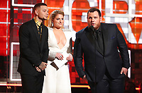 Kane Brown, from left, Meghan Trainor and Luke Combs present the award for best country album at the 61st annual Grammy Awards on Sunday, Feb. 10, 2019, in Los Angeles. (Photo by Matt Sayles/Invision/AP)