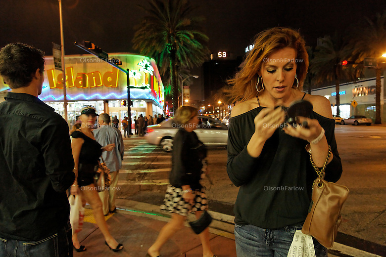 Lincoln Road at Collins where mixtures of people come together. Amy Perupera looks her best as she hands out free tickets to a oncert.