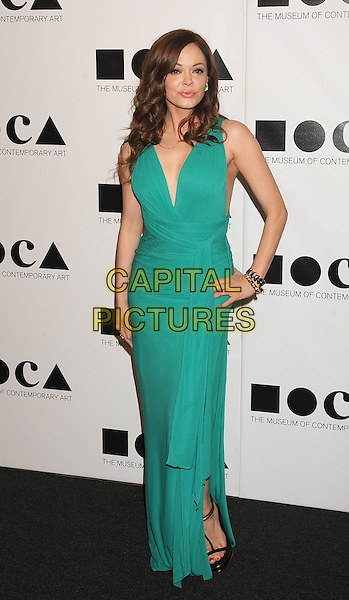 """Rose McGowan.The 2011 MOCA Gala """"An Artist's Life Manifesto"""" With Artistic Direction From Marina Abramovic held at MOCA Grand Avenue in Los Angeles, California, USA,.12th November 2011..full length green dress maxi turquoise hand on hip .CAP/ROT/TM.© TM/Roth/Capital Pictures"""