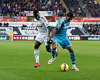 SWANSEA, WALES - FEBRUARY 07: L-R Nathan Dyer of Swansea loses the ball to Patrick Van Aanholt of Sunderland during the Premier League match between Swansea City and Sunderland AFC at Liberty Stadium on February 7, 2015 in Swansea, Wales.