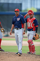 GCL Nationals manager Mario Lisson and catcher Wilmer Perez (14) on the mound during a game against the GCL Astros on August 6, 2018 at FITTEAM Ballpark of the Palm Beaches in West Palm Beach, Florida.  GCL Astros defeated GCL Nationals 3-0.  (Mike Janes/Four Seam Images)