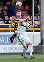 Alloa's Michael Doyle and Dumbarton's Dumbarton's Bryan Prunty challenge for the ball.