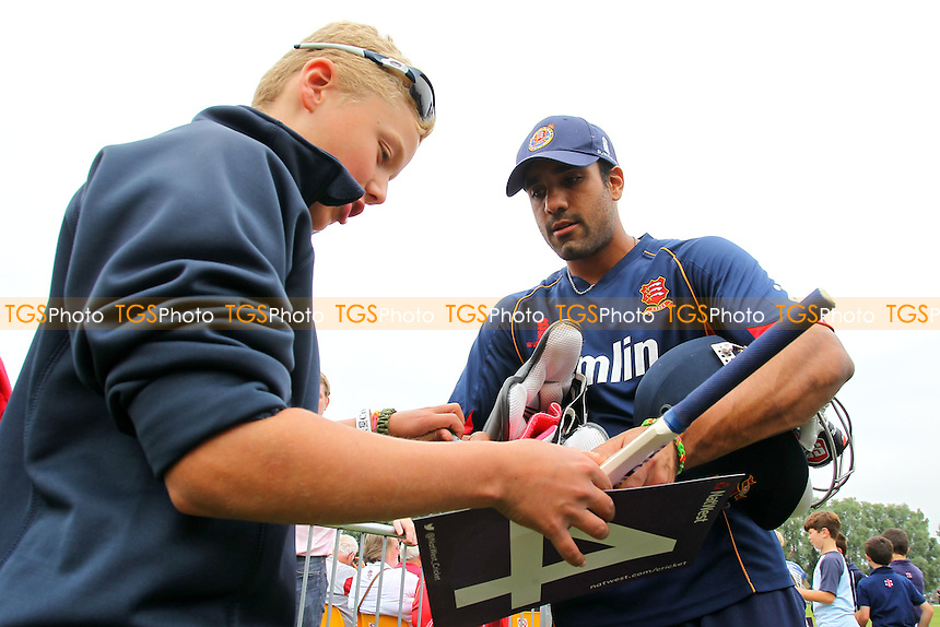 Ravi Bopara of Essex signs an autograph for a fan - Essex Eagles vs Kent Spitfires - NatWest T20 Blast Cricket at Castle Park, Colchester, Essex - 12/07/14 - MANDATORY CREDIT: Gavin Ellis/TGSPHOTO - Self billing applies where appropriate - contact@tgsphoto.co.uk - NO UNPAID USE