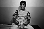 Dourados, Guarani reserve. Ernesto, 17, drunk and in abstinence crisis, in the Jesuit hospital of the reserve.