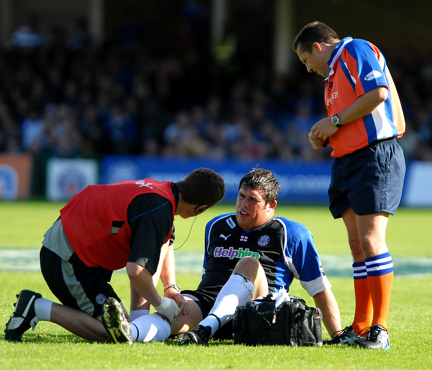 Photo: Ed Godden..Bath Rugby v Ospreys. EDF Anglo-Welsh Cup. 07/10/2006..Bath's Duncan Bell receives treatment on the pitch.
