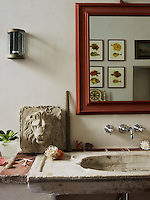 One of a pair of antique stone wash basins in the bathroom