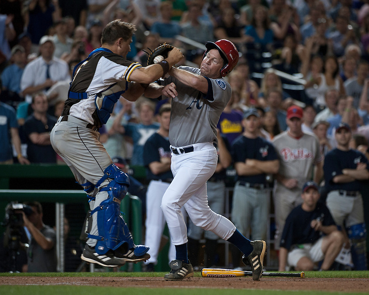 Democrats' catcher John Boccieri, D-Ohio, holds onto the ball as Rep. Connie Mack, R-Fla., charges home plate during the 49th Annual Roll Call Congressional Baseball Game at Nationals Stadium in Washington on Tuesday, June 29, 2010.