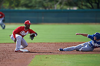 Cincinnati Reds J.D. Salmon-Williams (58) waits for a throw as Jordan Tarsovich (85) slides into second during an instructional league game against the Los Angeles Dodgers on October 20, 2015 at Cameblack Ranch in Glendale, Arizona.  (Mike Janes/Four Seam Images)