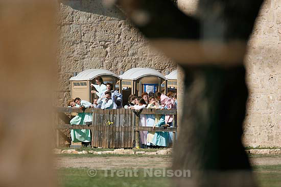 San Angelo - FLDS women stand behind a fence at Fort Concho, waving to other FLDS women in another building and to news photographers. Texas Child Protective Services said they have taken 401 children from the YFZ Ranch into protective custody as of Monday, April 7, 2008 and brought them to Fort Concho..