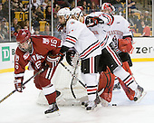Alex Fallstrom (Harvard - 16), Justin Daniels (Northeastern - 11), Drew Daniels (Northeastern - 24), Chris Rawlings (Northeastern - 37) - The Northeastern University Huskies defeated the Harvard University Crimson 4-0 in their Beanpot opener on Monday, February 7, 2011, at TD Garden in Boston, Massachusetts.