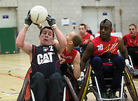 27 MAY 2013 - DONCASTER, GBR - Jamie Stead of the Leicester Tigers battles to retain position during the 2013 Great Britain Wheelchair Rugby Nationals 5th / 6th place deciding match against East Midlands Marauders at The Dome in Doncaster, South Yorkshire, Great Britain (PHOTO (C) 2013 NIGEL FARROW)