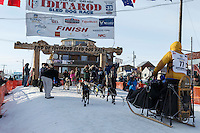 Alan Stevens runs across the finish line in Nome on Saturday March 21, 2015 during Iditarod 2015.  <br /> <br /> (C) Jeff Schultz/SchultzPhoto.com - ALL RIGHTS RESERVED<br />  DUPLICATION  PROHIBITED  WITHOUT  PERMISSION