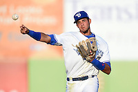Dunedin Blue Jays  shortstop Emilio Guerrero (13) throws to first during a game against the Brevard County Manatees on April 11, 2014 at Florida Auto Exchange Stadium in Dunedin, Florida.  Brevard County defeated Dunedin 5-2.  (Mike Janes/Four Seam Images)