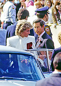 "Princess Diana and Prince Charles are surrounded by security as they return to their limo after working the crowd following their visit and tour of the J.C. Penney department store ""Best of Britain"" merchandise sale in Springfield, Virginia on November 11, 1985.<br /> Credit: Howard L. Sachs / CNP"