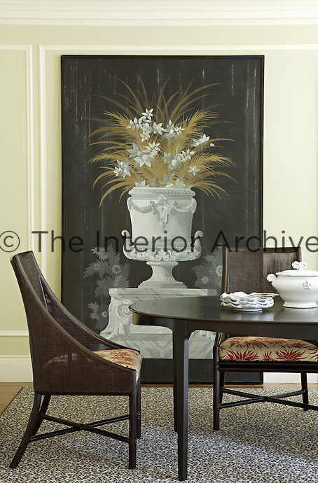 The dining room is dominated by a 20th century French painting of an urn which rests artist's style on the floor