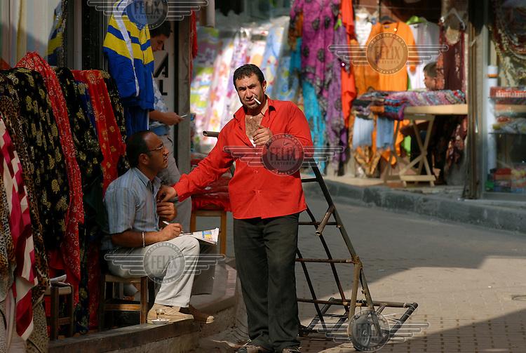 Market worker taking a cigarette break in central Istanbul.