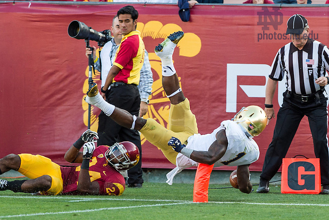Nov. 29, 2014; Running back Greg Bryant (1) dives for the end zone in the third quarter against the USC Trojans at the Los Angeles Memorial Coliseum. (Photo by Matt Cashore)