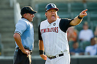 Kannapolis Intimidators manager Tommy Thompson #39 has a heated argument with home plate umpire Jose Esteras after being ejected from the game against the Delmarva Shorebirds at Fieldcrest Cannon Stadium on August 7, 2011 in Kannapolis, North Carolina.  The Intimidators defeated the Shorebirds 8-3.   (Brian Westerholt / Four Seam Images)