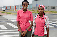 ETHIOPIA , Southern Nations, Hawassa or Awasa, Hawassa Industrial Park, chinese-built for the ethiopian government to attract foreign investors with low rent and tax free to establish a textile industry and create thousands of new jobs, taiwanese company Everest Textile Co. Ltd.  / AETHIOPIEN, Hawassa, Industriepark, gebaut durch chinesische Firmen fuer die ethiopische Regierung um die Hallen fuer Textilbetriebe von Investoren zu vermieten, taiwanesische Firma Everest Textile Co. Ltd., links Hana Kassa (20, und rechts Menalech Zeneb (19)