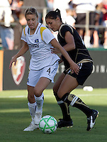 23 July 2009:  Aly Wagner of the Los Angeles Sol controls the ball away from Greer Barnes during the first half of the game at Buck Shaw Stadium in Santa Clara, California.   FC Gold Pride tied Los Angeles Sol, 0-0.