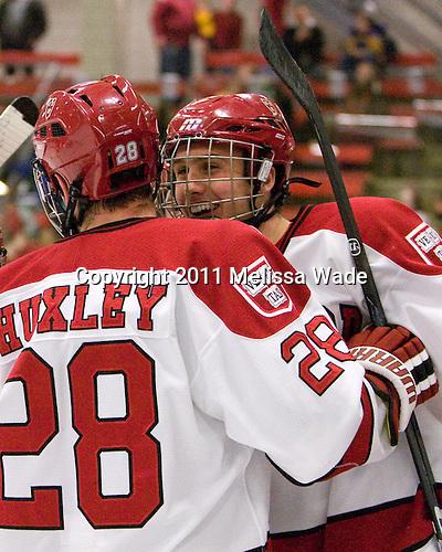 Chris Huxley (Harvard - 28), Danny Biega (Harvard - 9) - The Harvard University Crimson defeated the visiting Colgate University Raiders 6-2 (2 EN) on Friday, January 28, 2011, at Bright Hockey Center in Cambridge, Massachusetts.