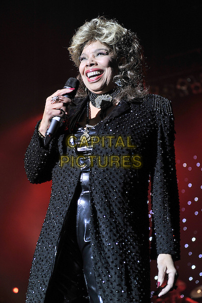 """MILLIE JACKSON.Performs as part of the """"Reggae got soul valentine showcase"""" at Brixton Academy, London, England, .February 13th 2011..music live on stage concert gig half length  microphone  black sparkly coat choker necklace leather trousers  singing smiling .CAP/MAR.© Martin Harris/Capital Pictures."""