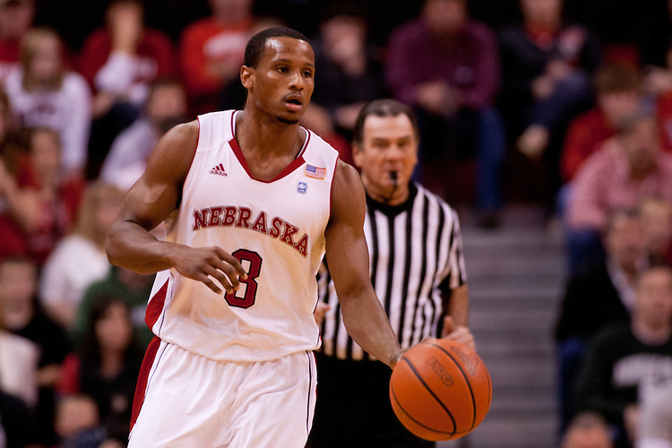 31 December 2011: Brandon Richardson #3 of the Nebraska Cornhuskers brings the ball down court during the first half against Michigan State Spartans at the Devaney Sports Center in Lincoln, Nebraska. Michigan State defeated Nebraska 68 to 55.