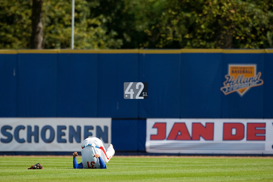 14 September 2009: Jong-Wook Ko of South Korea stretches prior to the 2009 Baseball World Cup Group F second round match game won 15-5 by South Korea over Great Britain, in the Dutch city of Amsterdan, Netherlands.
