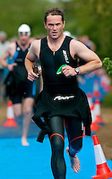 09 MAY 2010 - GRENDON, GBR - A competitor heads for transition after exiting the swim during the Grendon Triathlon .(PHOTO (C) NIGEL FARROW)