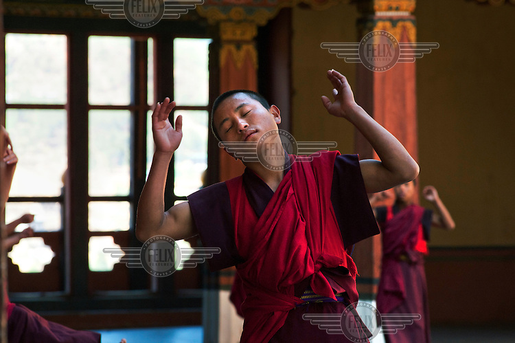 A monk from the Paro Dzong Monastery reherses a ritual dance in preparation for the Paro Tsechus Festival.